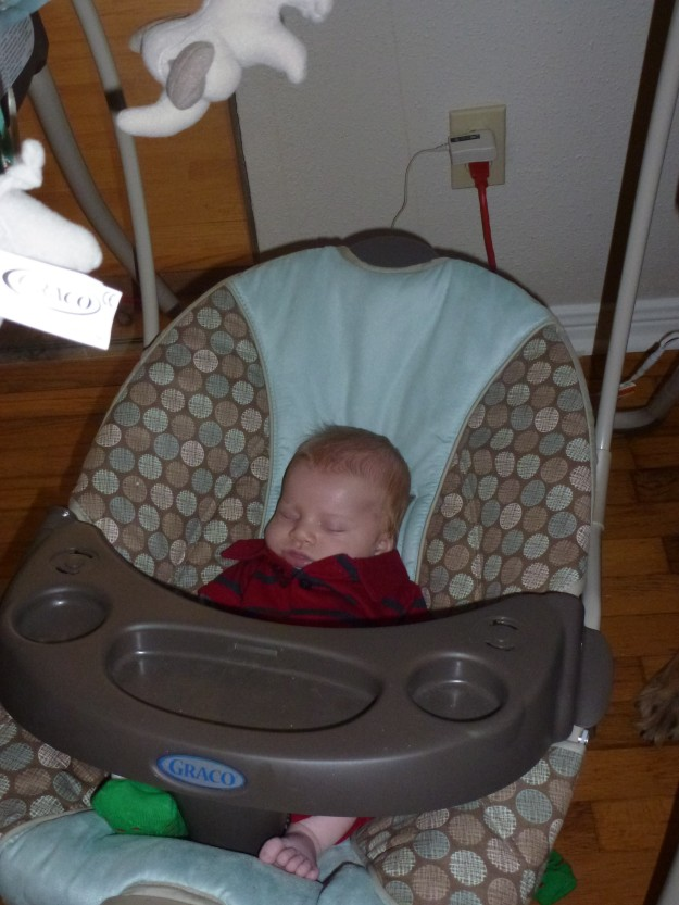 Baby sleeping in swing